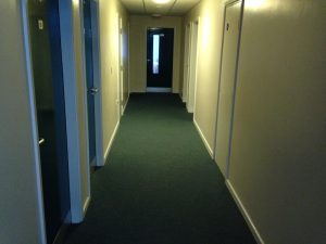 The kitchen's at the far end of the narrow corridor